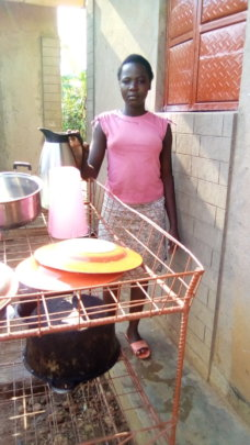 AN ORPHAN GIRL CHILD ENGAGED IN DOMESTIC WORK
