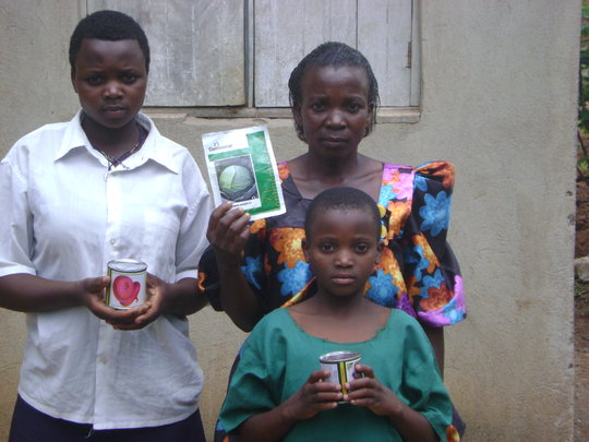 A WIDOW WITH HER ORPHAN GIRLS RECEIVES SEEDS