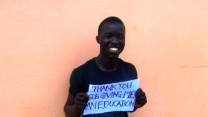 Julius in high school is grateful for his education!.JPG