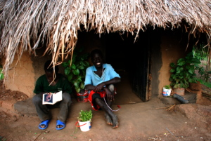 Julius reading next to Sebastian outside their reading hut.JPG