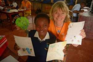 Esther with her sponsor's letters and pictures