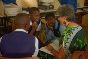 Director Rinda Hayes meets with sponsored students