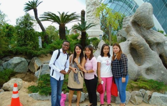 Salim, leading a tour in China