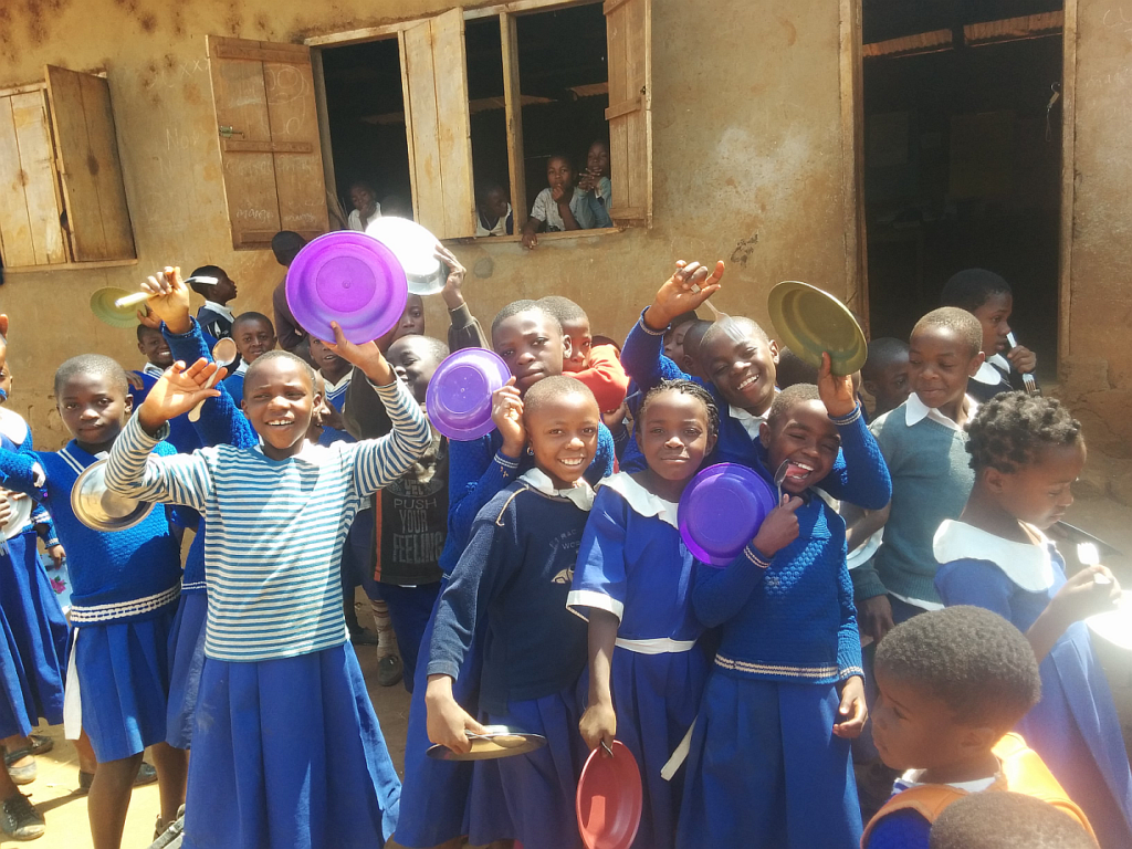 Healthy children benefiting from their harvest
