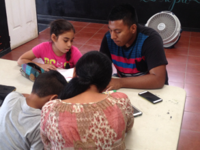 Miguel, tutoring a young person in his community.