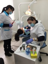 SOAR dental clinic nurse cleaning teeth of a child