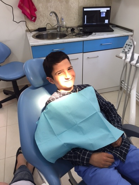 A young boy receiving care at SOAR Dental Clinic
