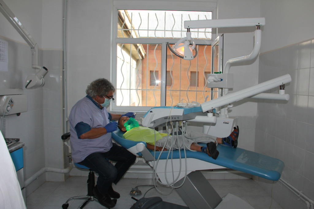 Dentist providing care at Tsaghgadzor Summer Camp