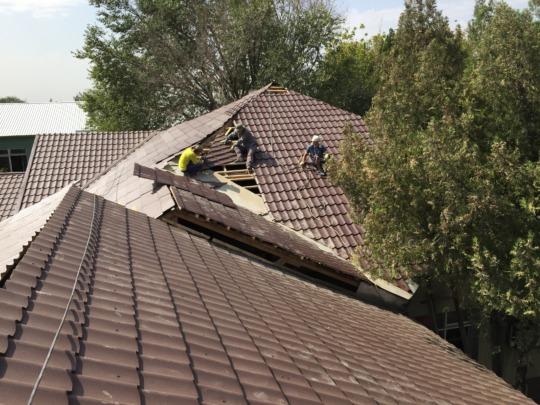Work underway on the roof