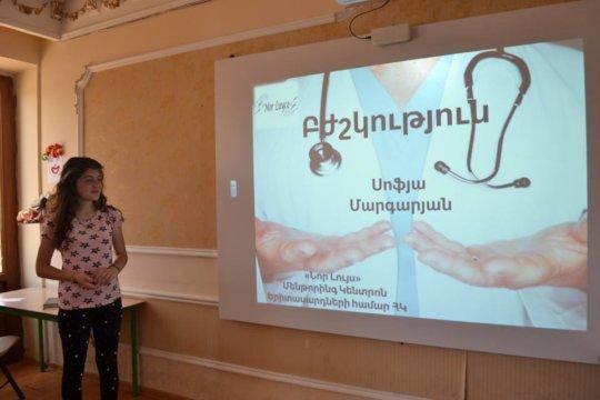 A mentees giving a presentation