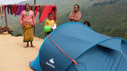 Family in Lekh with tent, food and toys