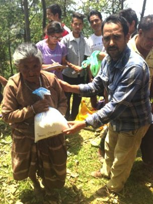Distributing rice and dal to villagers