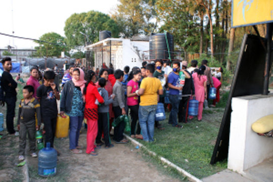 fetching-water-in-camp