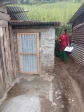 A PHASE supervisor observing a newly built toilet