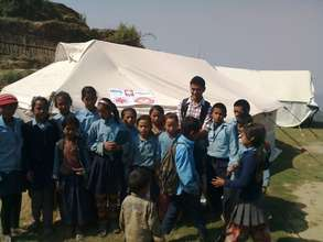Children outside a school tent
