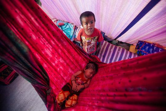 Som's children in their makeshift tent.