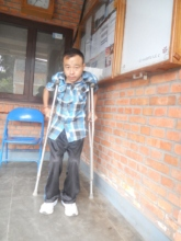 Chitra walks on his own with crutches