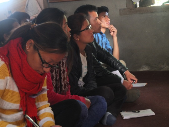 Dhading students listen to a lecture on healthcare