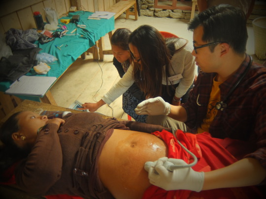 HHC staff and volunteers treat a mother-to-be