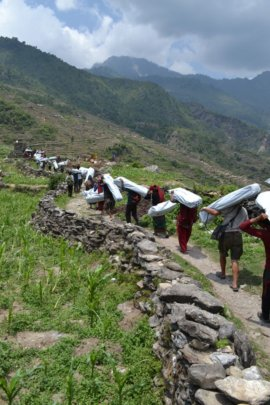 HHC volunteers carry supplies to northern Dhading