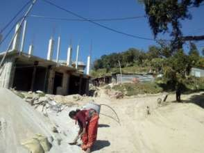 Women rebuilding their homes in the Kavre district