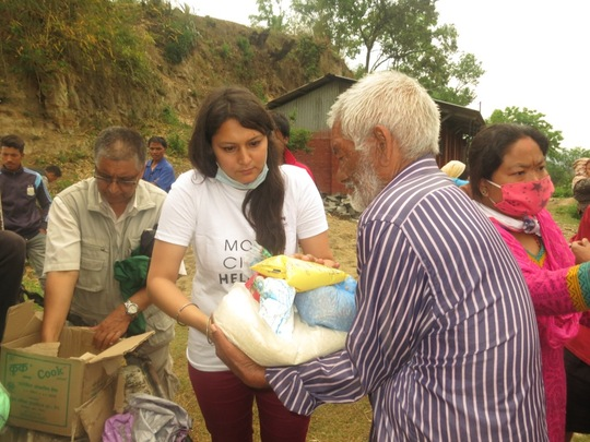 Mobile Helpdesk volunteer assisting Nepali man after the earthquake