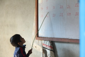 Child learning at Global Reach School