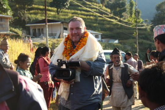 Ron greeted by school built by Global Reach