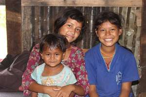 Children in front of their temporary shelter