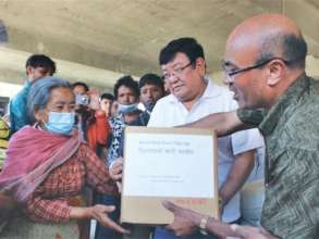 Dr. Ruit distributing relief aid after the quake