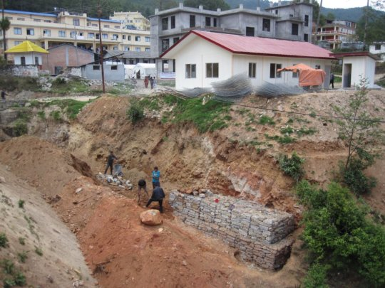 Landslide Wall being built beneath the new clinic