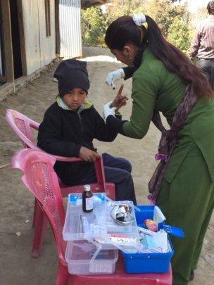 Teacher using ETC-provided first aid kit