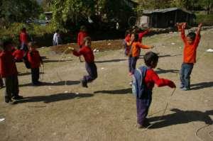 Students enjoying ETC-provided playground items