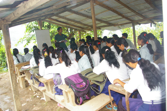 Grade 10 students in their temporary classroom
