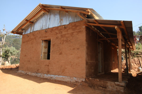 A BRAC demonstration house built by local masons.