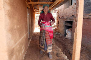 Bescu, 84, a recipient of a new BRAC home.
