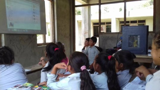 Students learning on Projector