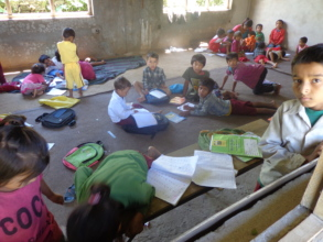 Kids studying   in the yard under the sun