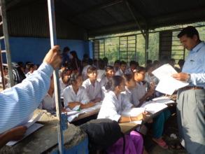 A teacher in the  CLASS ROOM