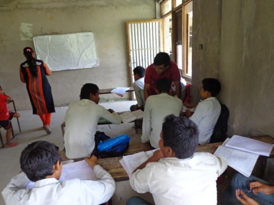 Teacher teaching the students