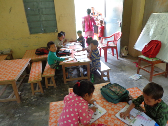 Lower class student doing their classworks