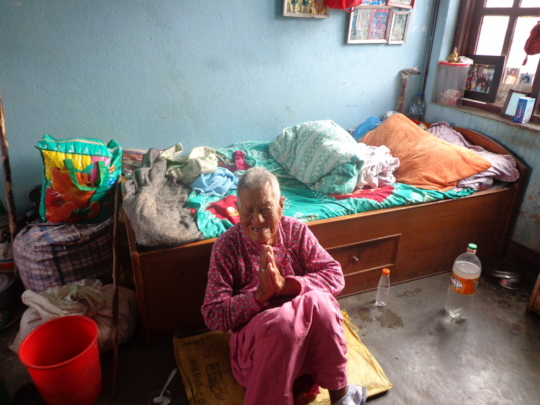 An old woman in her bed room
