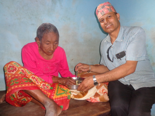 CDC chairperson feed an old woman