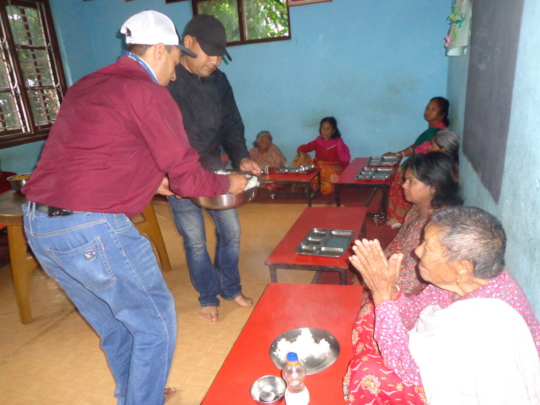 CDC chairman serving food  to the elderly people