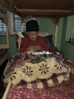 An old woman weak  in her bed