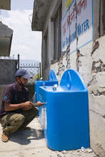 Rajendra, on the Splash-Nepal team, makes repairs
