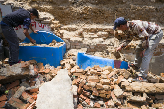 Splash Nepal staff dig systems out from rubble
