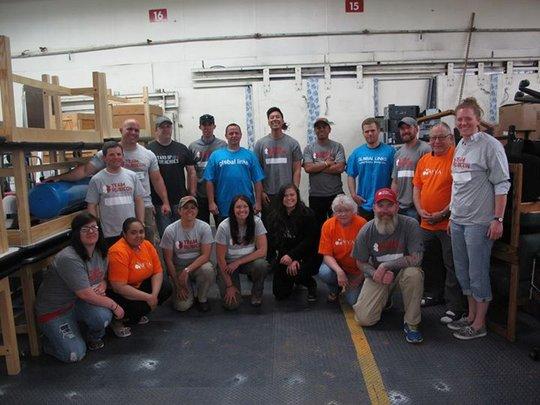 Volunteers & staff prepping medical materials