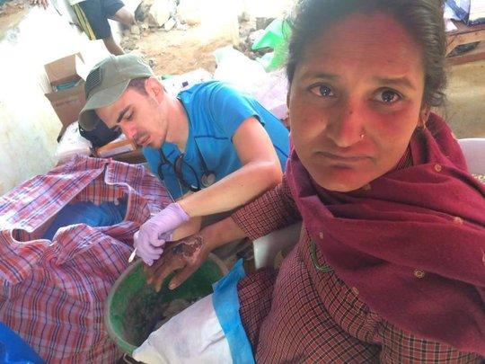 Dr. Miller treating patient in Sindupalchok