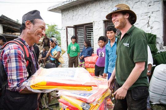 Dom Hunt distributes tarps in Sindhupalchok